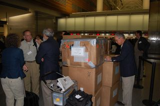 Volunteers and boxes leaving SFO
